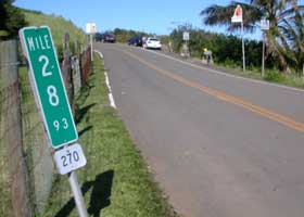 Beginning of the Akoni Pule Highway (state route 270) at the Polulu Valley Lookout, heading back toward Kawaihae; terminal milepost 28.93 at the left