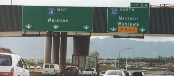Overhead signs on westbound H-1, approaching exit for northbound H-2