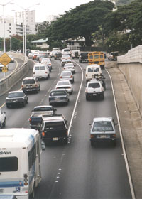 Approaching an entrance ramp, with Botts dots marking the three lanes and a white stripe on the left side of the dots between the #2 and #3 lanes