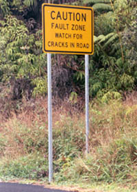Caution - Fault Zone - Watch for Cracks in Road