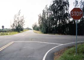 Red Road, with black pavement, facing south at intersection with county 132
