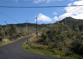 Narrow but paved Kalako Drive, zigzagging up toward antennas on west slope of Hualalai volcano