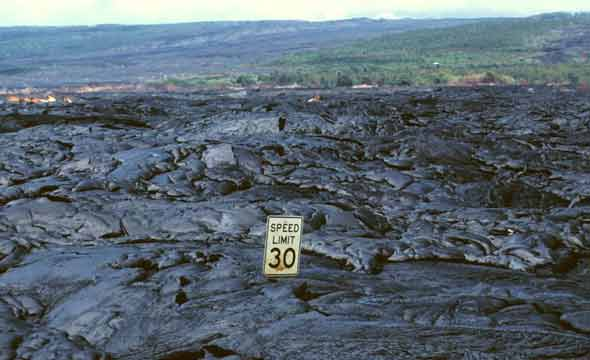 30 mph speed limit sign, embedded in hardened pahoehoe lava almost up to bottom of sign