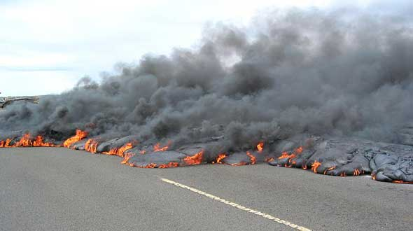 Asphalt meets fiery and smoky end, as lava starts to cover road