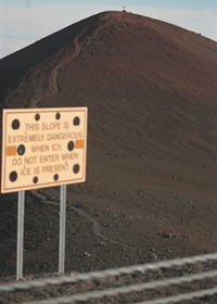 Trail to Pu'u Wekiu, high point on Mauna Kea summit; sign reads 'This Slope Extremely Dangerous When Icy | Do Not Enter When Ice Is Present'