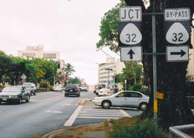 'By-pass' 32 route marker in downtown Wailuku, next to route marker indicating main route is ahead