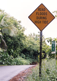 Sign warning of flooding at high tide