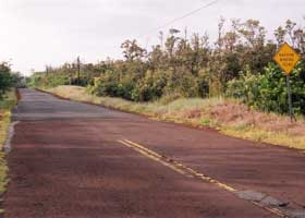 Red Road facing south, as old red pavement changes to new black pavement