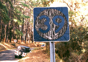 Aged old Route 39 sign (black on white circle on black square)