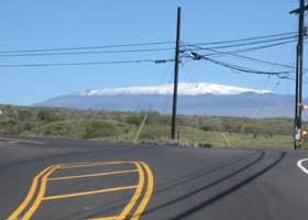 South end of state route 270, with snow-covered Mauna Kea summit in background